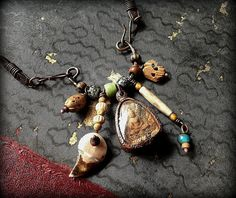 Tribal assemblage necklace with Buddha talisman bone by quisnam, $50.00