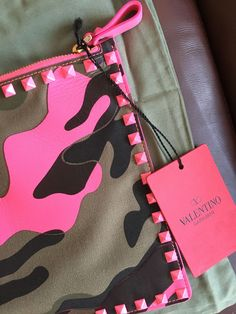 Valentino Camouflage Pink Army Green Clutch Rockstud Camouflage Flat PouchTop Zipper Closure Hot Pink and Army GreenPrinted canvas and leather feature fabric lining and g Valentino Camouflage, Pink Camouflage, Designer Handbags Uk, Military Chic, Green Clutches, Camo Fashion, Pink Clutch, Warm Weather Outfits, Ideas