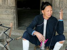 A Lanten ethnic minority woman spinning cotton Ban Pakha Luang Namtha province Lao PDR The Lanten or Yao Mun are a small but distinctive group of the...