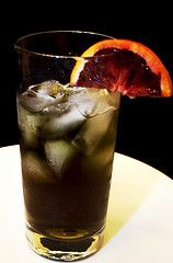 The Headless Horseman - 2 oz black vodka  3 dashes bitters  Ginger ale    Directions:  Pour the vodka and bitters into a Collins glass. Fill the glass with ice, then pour in ginger ale.  Garnish with a slice of blood orange.