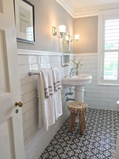love the subway tile graphic patterned floor and gray paint small bathroom pedestal sink