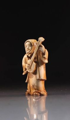 Japanese finely incised, delicately carved netsuke figure, depicting figure with a handkerchief wrapped about her head, playing a biwa, early 20th century period, artist's signature to the base. Size; Height of netsuke carving is 2 1/8 inches.