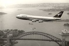 Qantas B747-200 flying over Sydney Harbour, early 1970s
