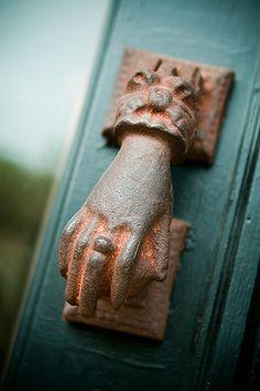 love the hand doorknob