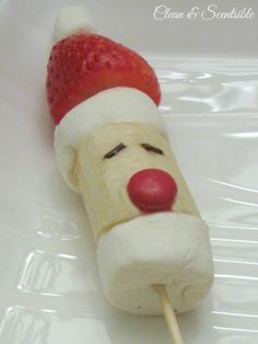 Fruit Santa Pops ~ Cut a large marshmallow in half and place a banana slice between them. {If you are not going to be eating these right away, dip the banana in lemon or orange juice to avoid browning}. Top with a strawberry and small marshmallow. Use a couple of chocolate sprinkles for the eyes and an M M for the nose. Skewer on a stick for a fun fruit pop.