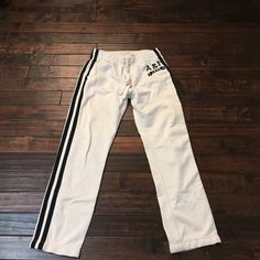 White workout pants with navy blue stripes White workout or lounge around pants with navy blue stripes down the side and logo on the left front hip. Does have pockets. Good condition Abercrombie & Fitch Pants Track Pants & Joggers