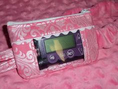 Pink Hollywood Sparkle Damask Window Insulin Pump Pouch Case Pink Hollywood Sparkle Damask Window Insulin Pump Case adorned with irridescent ric rak or your choice of colors #designyourowninsulinpumpcase #insulinpumppouchwithwindow #custommadeinsulinpumpcase #minimedinsulinpumppouch #insulinpumpcasesforgirls #kidsinsulinpumpcases