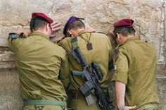 IDF soldiers pray at Western/Wailing Wall in Jerusalem.