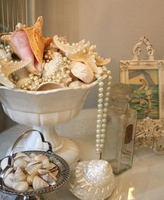 Shells...I have a bowl set up just like this!  Will add the strand of pearls, I also have, but didn't thin