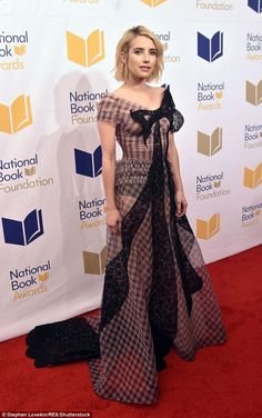 Stylish: The actress turned heads in a floor-length dress made of sheer beige checkered ma...