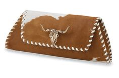 """Longhorn Baguette Clutch    Item # 10798      Crow's Nest Exclusive.   Blaze a trail. Take luxury to the limit with a long stretch of hair-on hide edged in neat, white leather whip-stitching. The brass steer's head adds shine. Lamb suede lining, interior zipper pocket. 13½"""" w x 4½"""" h; 2½"""" gusset. Made in the USA.     Share on facebook Share on twitter Share on email More Sharing Services                Qty              Editor's Pick     Longhorn Baguette Clutch $990.00"""
