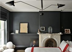 Jenna Lyons bedroom. dark slate walls, white bedding.