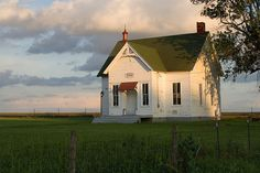 old schoolhouse  - common sight in the country where I grew up.  I attended two of them.