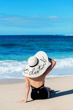Photographed on a beautiful beach in Hawaii, this black one-piece and adorable hat look amazingly...