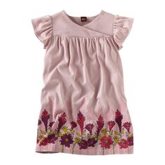The tropical ginger plant is known for its showy pink buds. We thought you were ready to let your showy side shine so we put them all over the border of this gorgeous cotton jersey dress. With a little wrap yoke neck just for fun. Imported.