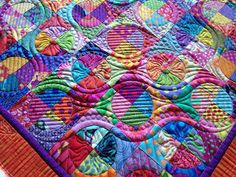 OMG I want to do this.  The fabrics and pattern are amazing....but the quilting is beyond belieg