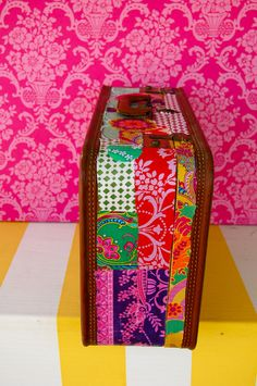 modge podge fabric on an old suitcase.  cute idea for storage