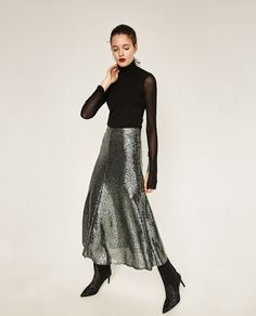 The 30 Parties Zara Thinks You're Going To This Holiday Season #refinery29  http://www.refinery29.com/2016/11/129680/zara-2016-holiday-collection-best-party-clothes#slide-11  There's nothing quite like being home for the holidays. Show off to your old high school classmates with a look that shines just the right amount.Zara Sequinned Midi Skirt, $69.90, available at Zara....