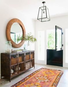 For the first time in my life I have a well-defined entry area that I am desperate to transform à la Heather Bullard. To change out my builder-grade flushmount fixture for a gorgeous pendant would be a dream, and finding a large-scale vintage mirror is on the top of my list if I make it …