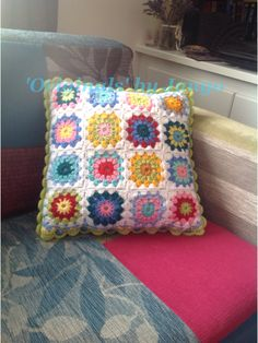 A crochet cushion I made to order. Made with the starburst (or is it sunburst?) style crocheted squares. Love the vibrancy of the colours!