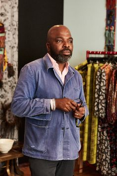 """The fashion designer and curator of the forthcoming exhibition """"Making and Unmaking"""" shares his ritual of getting dressed in the morning. Denim Button Up, Button Up Shirts, Duro Olowu, Black Fashion Designers, African American Fashion, T Magazine, Designer Wear, Get Dressed, Work Wear"""