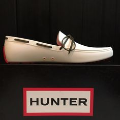 Hunter Driving Shoe White Boat loafers Shoe 8 New with box. Just tried on indoors! Hunter rubber driving shoe. Embossed branding. White Rubber upper. Moc-toe driver. Contrast brown lace detail. Red rubber outsole and heel guard. UK 6 - US 8 Hunter Boots Shoes Moccasins