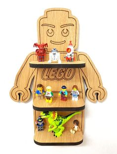 The lego wall shelf is Laser cut from 10mm Oak Veneer and hand Finished with engraved detail and danish oil Easy to put up with 2 hidden screws the fix behind the top shelf, This is 370mm tall. FREE Collection Welcome from our Studio in Spode Works Stoke on Trent.