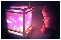 Ms Tara Wilson's daughter enjoying our Flying Girls lantern and the music box. Girl Gifts, Lanterns, Ms, Wonderland, Table Lamp, Daughter, Gift Ideas, Girls, Home Decor