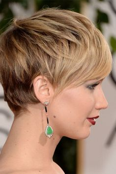 Jennifer Lawrence's crop is accessorised with statement earnings and a bold lip.