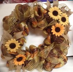 Deco mesh wreath in fall colors, on square wire frame, using burlap sunflowers. Listed for sale on Etsy.
