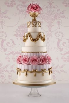 This cake is fit for a princess with those rose and gold trim and bows!
