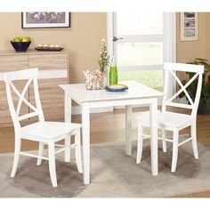 Perfect for a kitchen or breakfast nook the Ancona Dining Set by Simple Living offers two cross back chairs and a white square dining table.