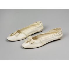 Pair of white leather wedding shoes with silk bow by unknown artist which were worn by Miss E. Brown in 1810, Britain. l Victoria and Albert Museum #Weddings