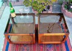 Keal/Saltman end tables on eBay. Very pretty, but you have to decide if the low height works for you.