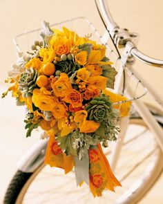 Orange and Pewter bouquet with touches of Green! And it's in a cute little bike basket!! Awww!! :-) #modcloth #wedding #FlowerArrangement