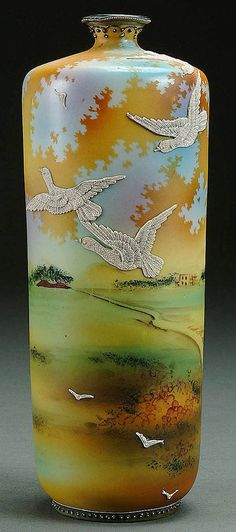 A NIPPON MORIAGE BIRDS IN FLIGHT DECORATED PORCELAIN VASE CIRCA 1915 WITH SCENE OF MORIAGE BIRDS IN FLIGHT ON A HAND PAINTED SCENIC COUNTRYSIDE GROUND