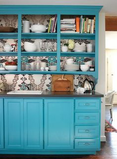 Love the wallpaper behind the built in. And the turquoise is awesome!