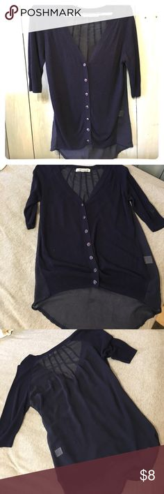 Blue 3/4 sleeve cardigan with sheer back Used Navy Cardigan with sheer back. Light fuzz on the front. 3/4 sleeve. Francesca's Collections Sweaters Cardigans