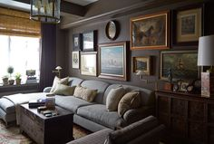 In the study, the Beare's collection of artlooks polished yet unstuffy when hung in an informal arrangement.