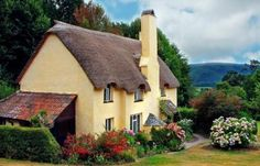 English cottage with thatched roof and wonderful view.