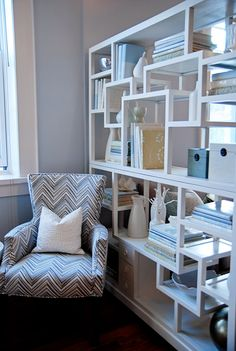 What looks to be 2 tall bookcases turned on their sides would be the perfect option to separate an office and craft space so the room can do double duty