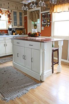 This could be done by adding length, as well. more cabinets and a longer piece of wood for the top