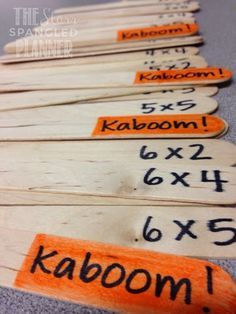 Answer correctly and keep your popsicle stick. Pick a Kaboom! stick and put all of yours back into the cup. Get 10 sticks to win.