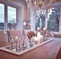 Love the idea of incorporating a mirror for a centerpiece...don't like the stuff on it