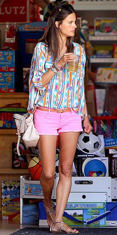 ALESSANDRA AMBRÓSIO Frankly, we're surprised that after all the colorful denim this spring, we aren't seeing more colorful cutoffs. The model mama wears a pink pair by Black Orchid with an even more attention-grabbing, geometric-print top. Excuse us while we reach for our credit cards...