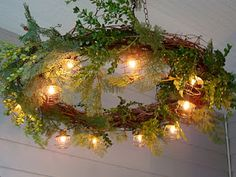 Grapevine Wreath Chandelier. Fresh herbs clipped to it to dry would smell amazing! :)