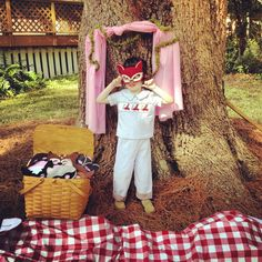 Woodland party photo booth with woodland animal masks.