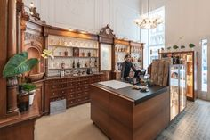 Das Alimentari - Delikatessen in der ehemaligen Paulaner Apotheke.⠀ Portrait, Vienna, Table, Photography, Furniture, Home Decor, Pharmacy, Deli Food, Architecture