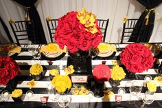 Red, yellow, black and white wedding table