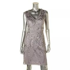 BNWT*SUE WONG Silver Applique Open Back Dress Manufacturer: Sue Wong Size: 6 Size Origin: US Manufacturer Color: Platinum Retail: $389.00 Condition: New with tags Style Type: Cocktail Dress Collection: Sue Wong Silhouette: Sheath Sleeve Length: Cap Sleeve Closure: Hidden Side Zipper Dress Length: Knee-Length Total Length: 37 1/2 Inches Bust Across: 16 1/2 Inches Waist Across: 13 1/2 Inchesp Material: 100% Nylon Fabric Type: Mesh Specialty: Padded Bust Sue Wong Dresses